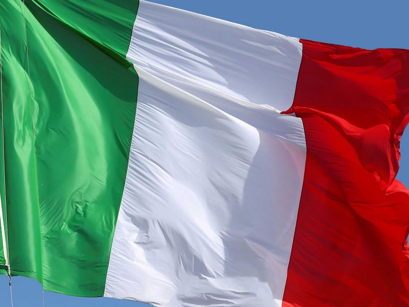 The Italian flag flutters in Rome, on May 1, 2011. Reuters/Massimo Sestini