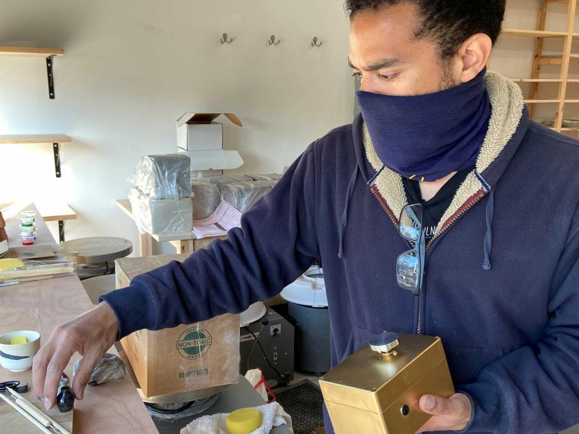 Co-owner of Mouse Ceramic Studio, Pedro Ramirez, holds a mini-wheel inside his closed studio, as his business is among thousands that have to try to find ways to reinvent themselves amid the coronavirus disease (COVID-19) outbreak, in Brooklyn, New York.
