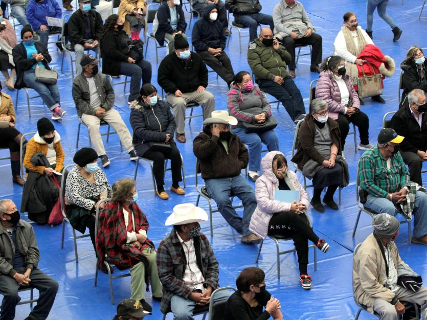 People wait seated to receive a dose of AstraZeneca coronavirus disease (COVID-19) vaccine at Municipal Gymnasium in Linares Mexico February 17, 2021.