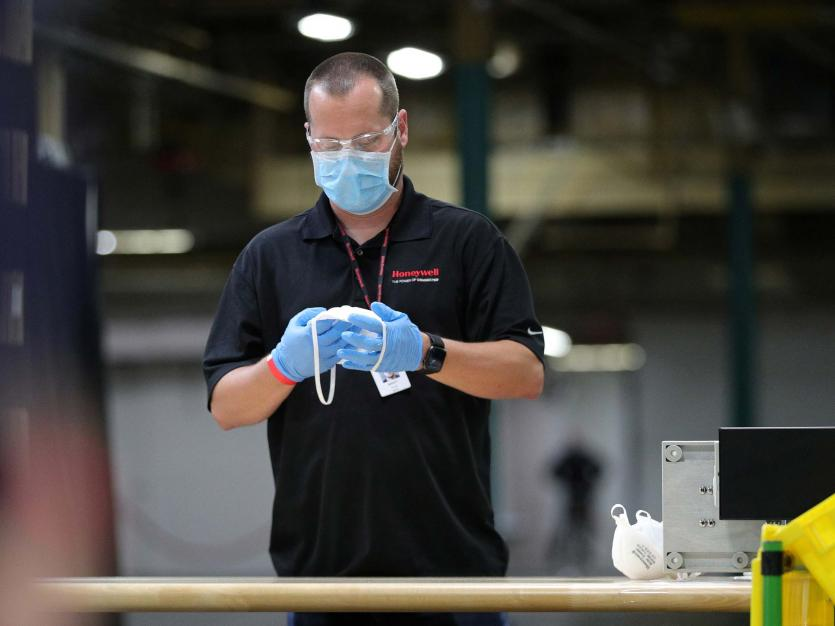 A Honeywell worker examines a face mask on the assembly line at the company's facility that manufactures masks for the coronavirus disease (COVID-19) outbreak in Phoenix, Arizona, U.S., May 5, 2020.
