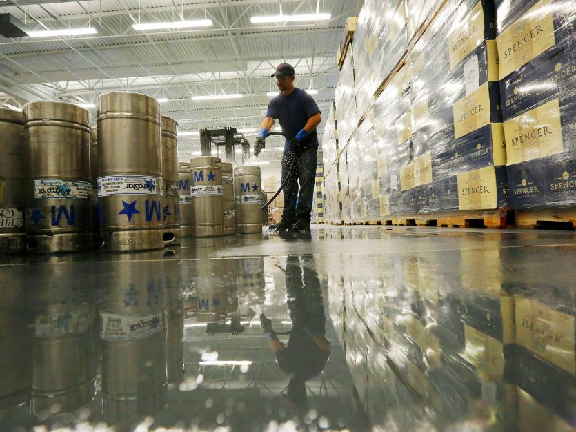 Kegs are cleaned in preparation of being filled with Trappist Ale brewed at Saint Joseph's Abbey, in Spencer, Massachusetts July 22, 2014. REUTERS/Brian Snyder