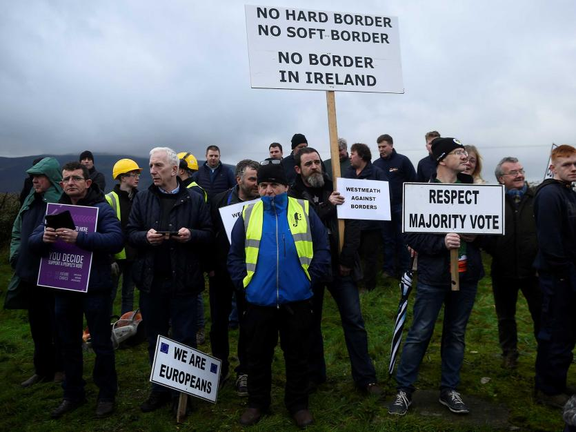 People hold signs during a protest by anti-Brexit campaigners, Borders Against Brexit in Carrickcarnan, Ireland, January 26, 2019. REUTERS/Clodagh Kilcoyne