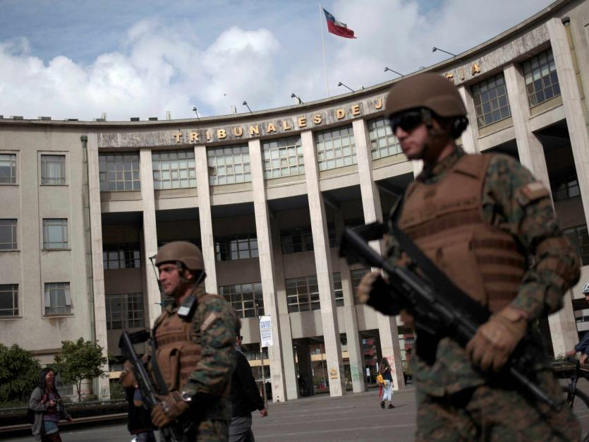 Soldiers stand guard outside the Supreme Court of Justice as protests over an increase in public transport prompted Chile's President Sebastian Pinera to declare a state of emergency, in Concepcion, Chile October 20, 2019.