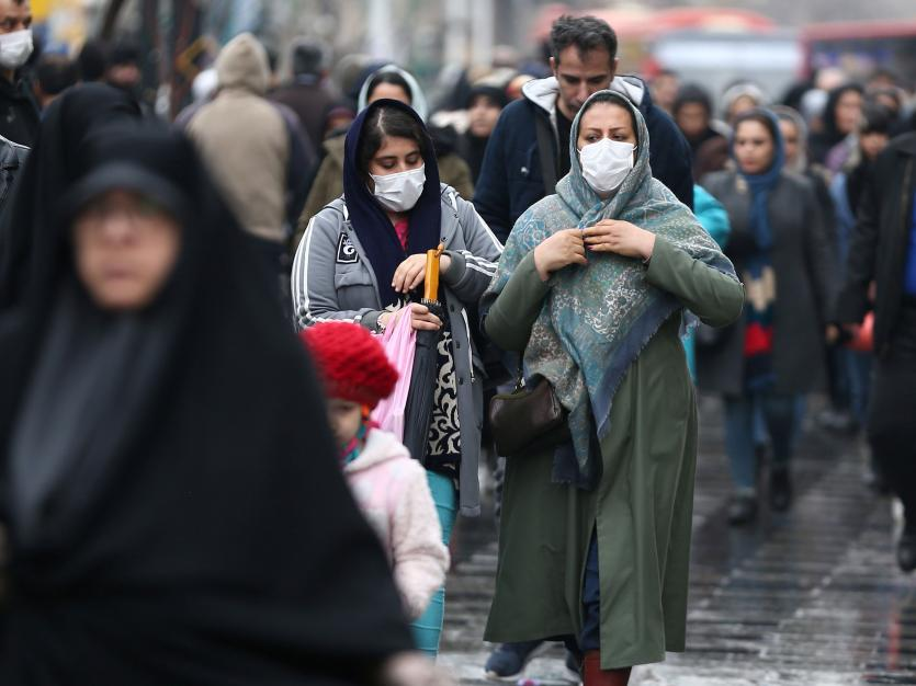 Iranian women wear protective masks to prevent contracting a coronavirus, as they walk at Grand Bazaar in Tehran, Iran February 20, 2020. WANA