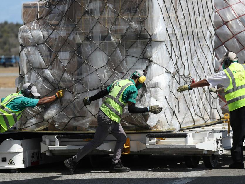 Workers move boxes of humanitarian aid arriving from China at Simon Bolivar International airport, during the national quarantine in response to the spread of coronavirus disease (COVID-19) outbreak, in Caracas, Venezuela March 28, 2020.
