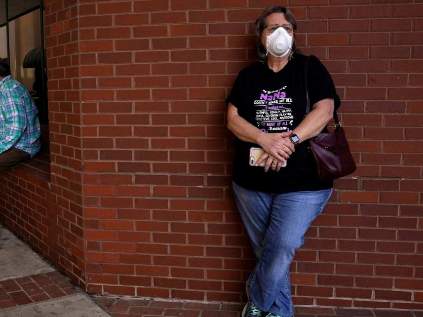 Regina Weaver who lost her job waits in line to file for unemployment following an outbreak of the coronavirus disease (COVID-19), at an Arkansas Workforce Center in Fort Smith, Arkansas, U.S
