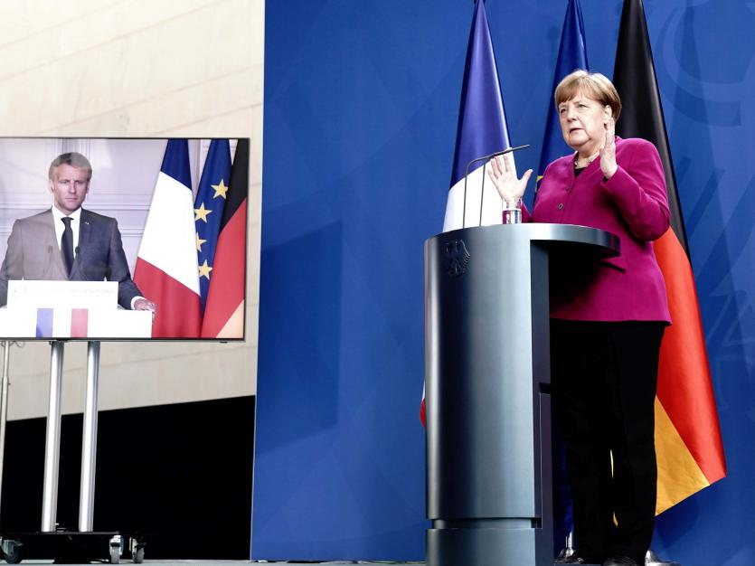 German Chancellor Angela Merkel holds a joint video news conference with French President Emmanuel Macron in Berlin, Germany, May 18, 2020.