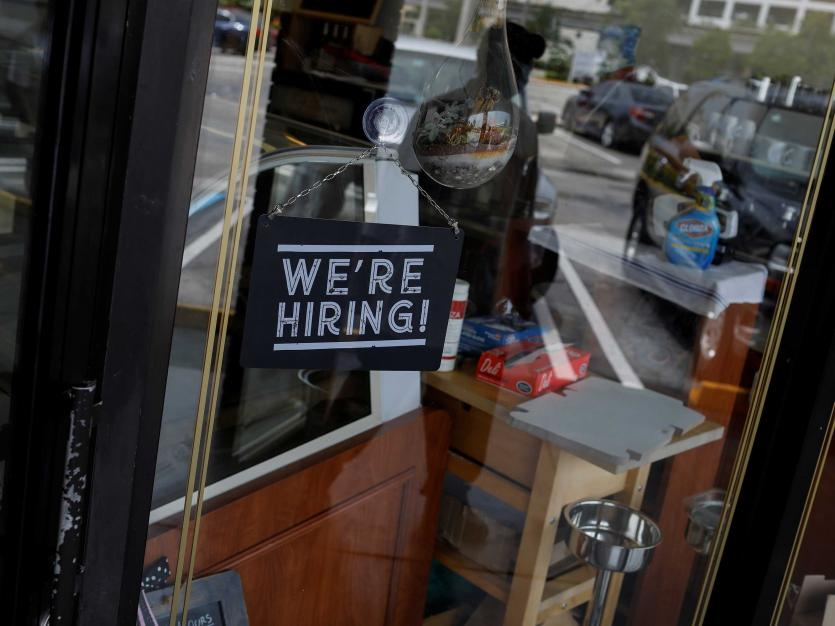 "A ""We're Hiring"" sign advertising jobs is seen at the entrance of a restaurant, in Miami, Florida, U.S. REUTERS/Marco Bello"