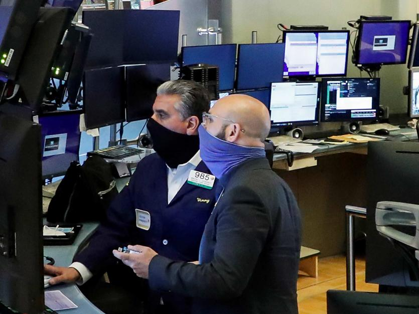 Traders on the floor at the New York Stock Exchange (NYSE) in New York, U.S., May 26, 2020.