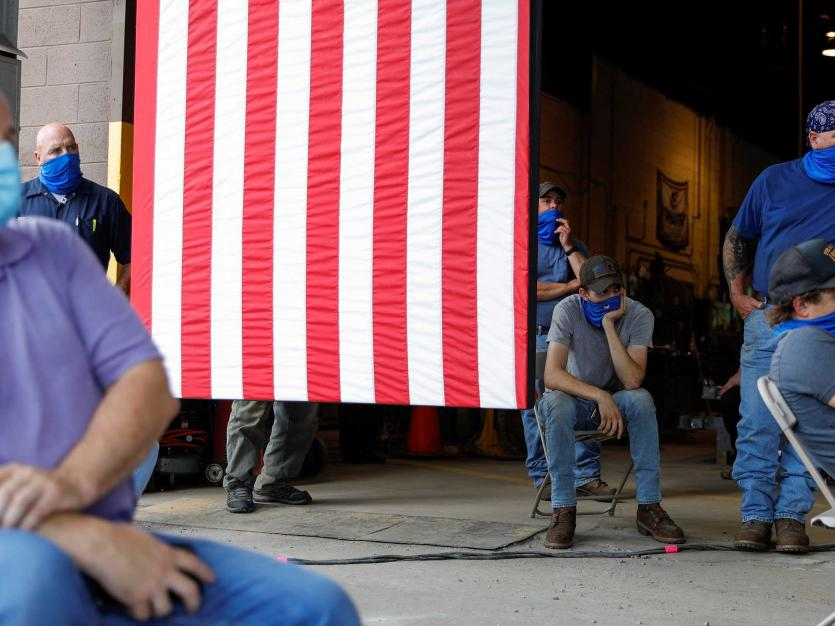 Workers separated for social distancing because of the coronavirus (COVID-19) pandemic listen to Democratic U.S. presidential candidate and former Vice President Joe Biden as he speaks about the U.S. economy during a campaign event at a metal works plant,