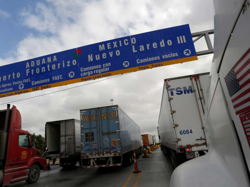 Trucks wait in the queue for border customs control to cross into U.S. at the World Trade Bridge in Nuevo Laredo, Mexico.