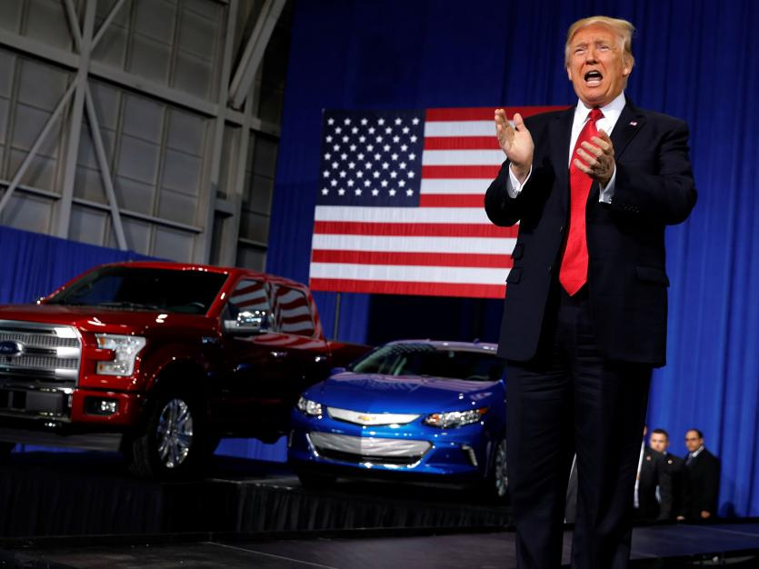 U.S. President Donald Trump takes the stage to deliver remarks at the American Center for Mobility, a test facility for driverless car technology for American Manufactured Vehicles in Ypsilanti Township, Michigan, U.S., March 15, 2017.