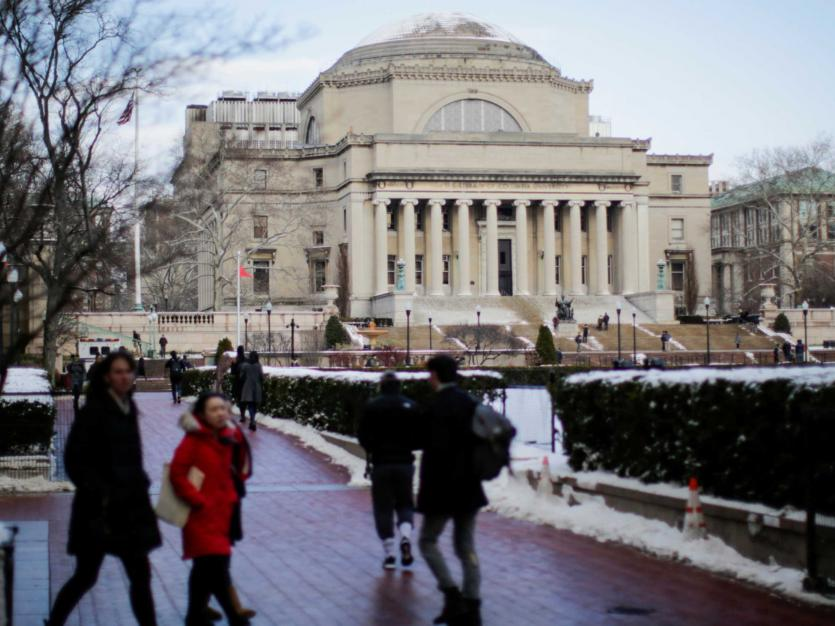 Students walk outside the Library of Columbia University in New York, U.S., December 16, 2017.