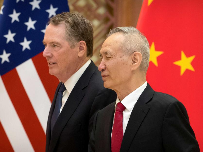 U.S. Trade Representative Robert Lighthizer, left, and Chinese Vice Premier Liu He arrive for a group photo at the Diaoyutai State Guesthouse in Beijing, China February 15, 2019. Mark Schiefelbein/Pool via REUTERS