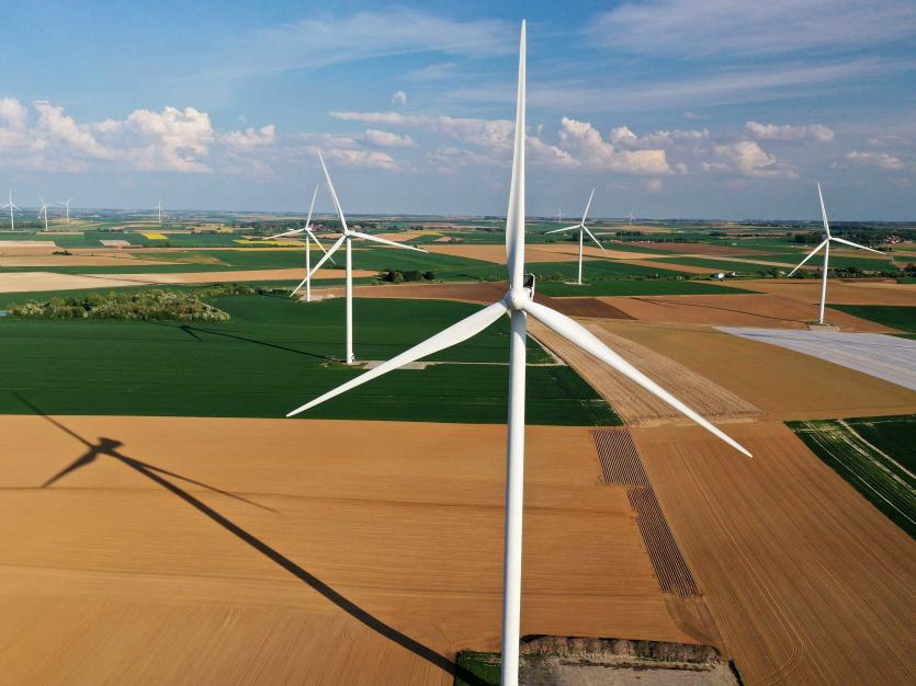An aerial view shows power-generating windmill turbines in a wind farm in Graincourt-les-Havrincourt, France, April 27, 2020. Picture taken with a drone REUTERS/Pascal Rossignol/File Photo