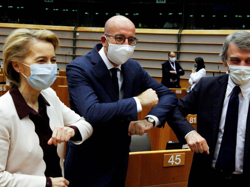 European Commission President Ursula von der Leyen, European Council President Charles Michel and European Parliament president David-Maria Sassoli greet each-other with an elbow bump during a plenary session on the conclusions of the extraordinary Europe
