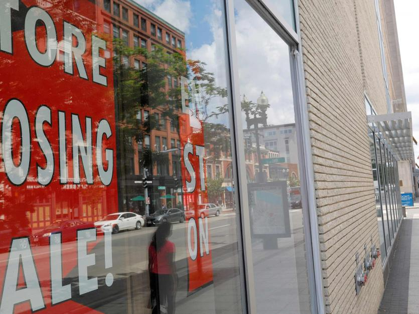 A sign in the windows of a department store advertises a store closing sale in Boston, Massachusetts, U.S., August 5, 2020.