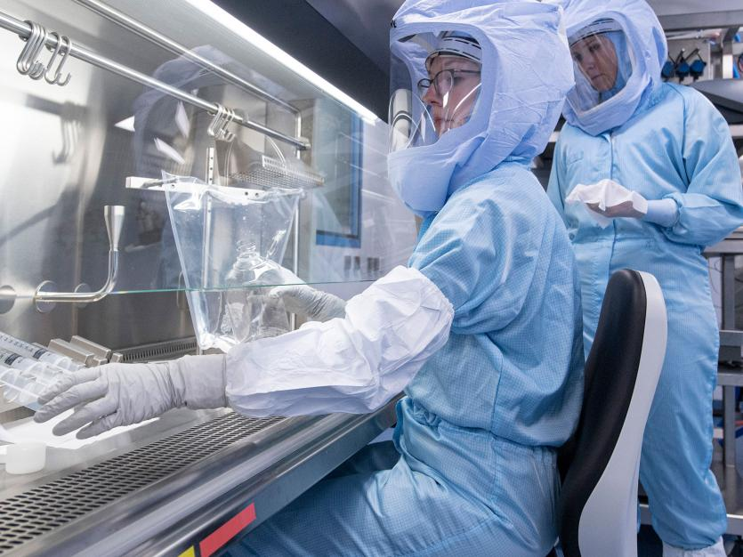 Wearing full-body protective suits, laboratory assistants from the company Biontech simulate the final steps in the production of the Corona vaccine on a bioreactor at the new production site in Marburg, Germany.