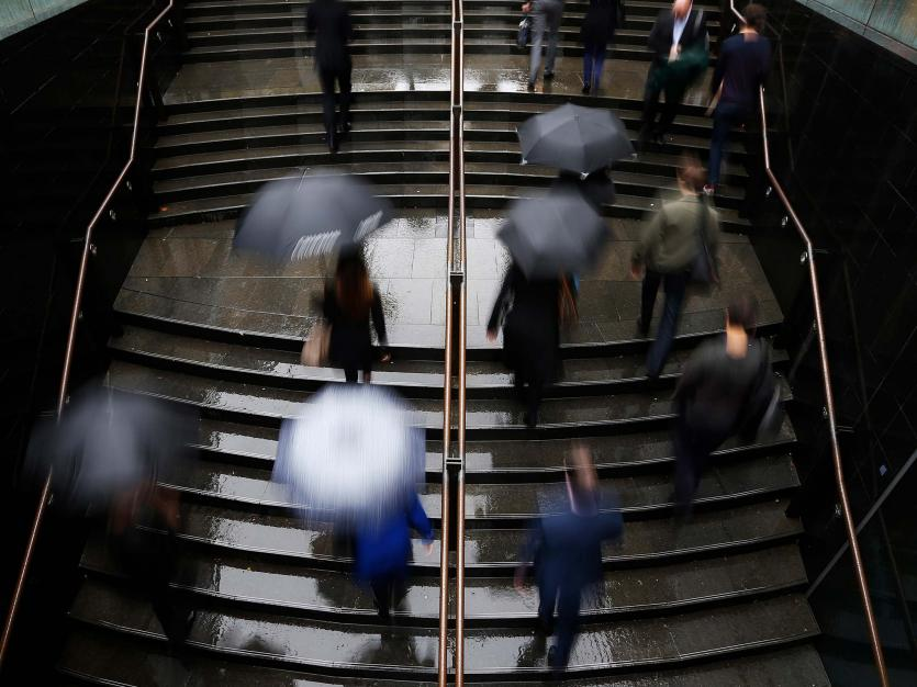 Commuters arrive to the Central Business District at the morning rush hour in Sydney.