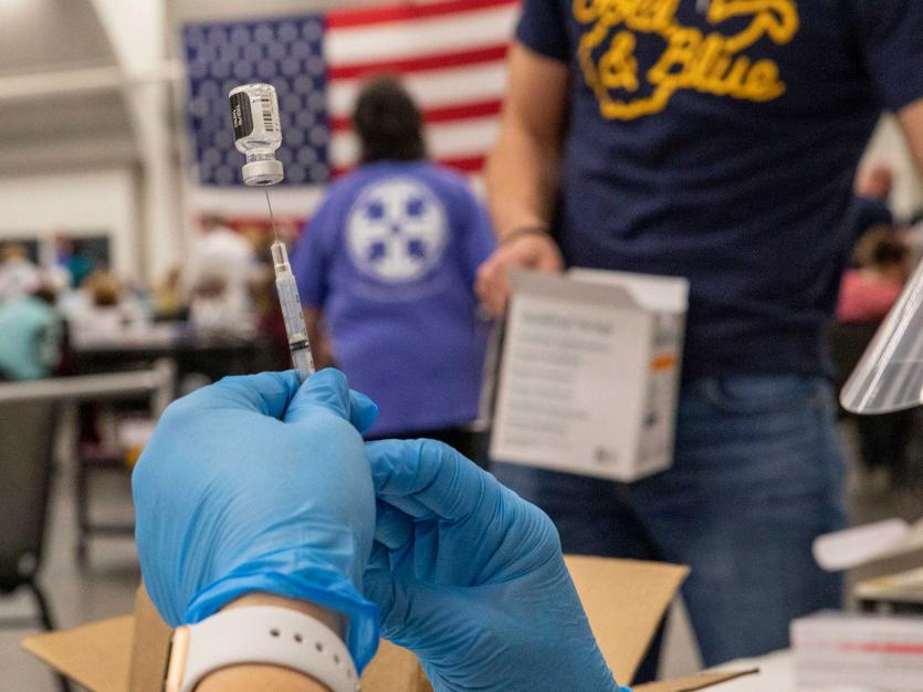 A medical worker prepares a syringe and an ampule with a dose of COVID-19 vaccinein Kanawha County, West Virginia.