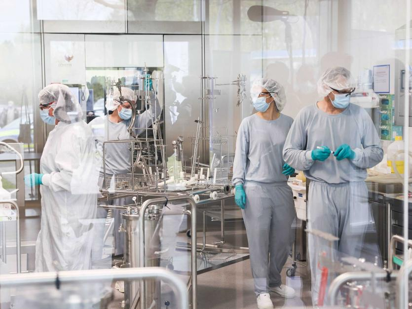 Employees in clean room work in the production of the Allergopharma plant in Reinbek near Hamburg, Germany