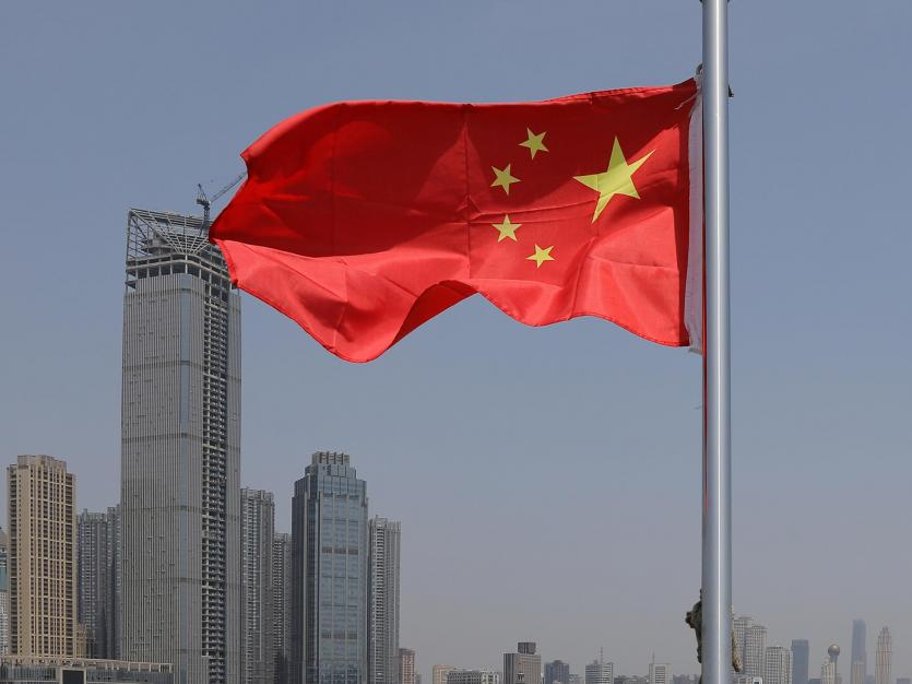 The Chinese national flag is pictured on a boat crossing the Yangtze River in Wuhan, Hubei province, China May 2, 2021.