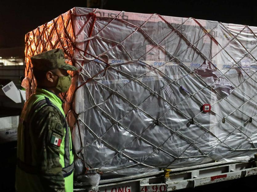 A soldier stands guard next to the first shipment of the AstraZeneca coronavirus disease (COVID-19) vaccine delivered under the COVAX scheme, at Benito Juarez's international airport in Mexico City, Mexico April 22, 2021.