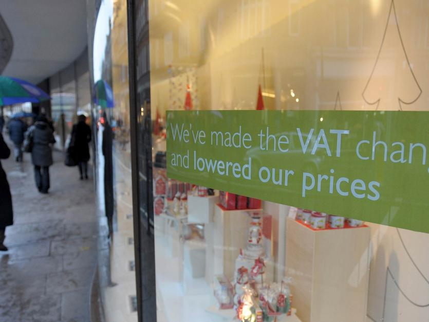 A value added tax (VAT) sign is seen in the window of the Peter Jones store in Sloane Square, in London November 30, 2008. The British government's temporary cut in VAT comes into force on Monday.