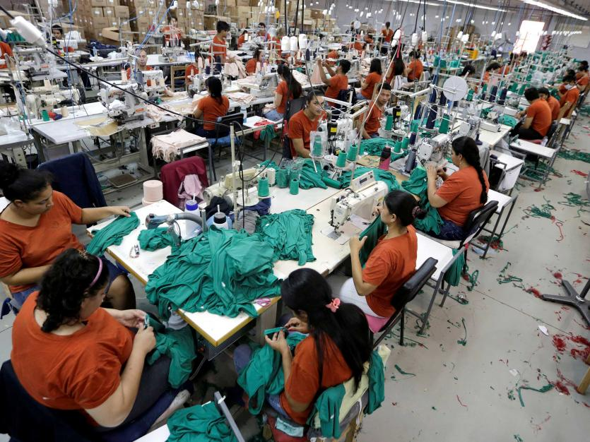 Workers assemble clothes for Brazilian retailer Riachuelo at the factory of Texcin in Limpio, Paraguay December 20, 2016
