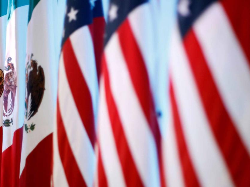 Flags of Canada, Mexico and the U.S. are seen before a joint news conference on the closing of the seventh round of NAFTA talks in Mexico City, Mexico March 5, 2018.