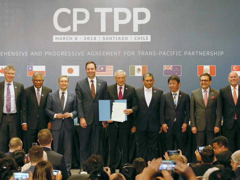 Representatives of members of Trans-Pacific Partnership (TPP) trade deal pose for an official picture after the signing agreement ceremony in Santiago, Chile, March 8, 2018.