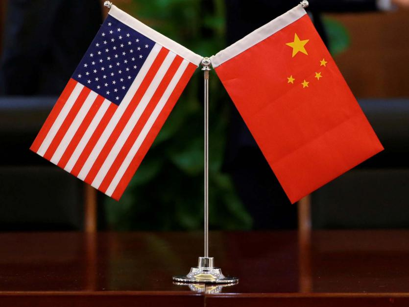 Chinese and U.S. flags are shown in Beijing, China April 27, 2018.