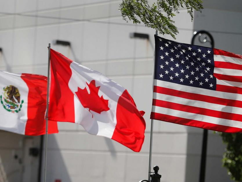 :  Flags of the U.S., Canada and Mexico fly next to each other in Detroit, Michigan, U.S. August 29, 2018.