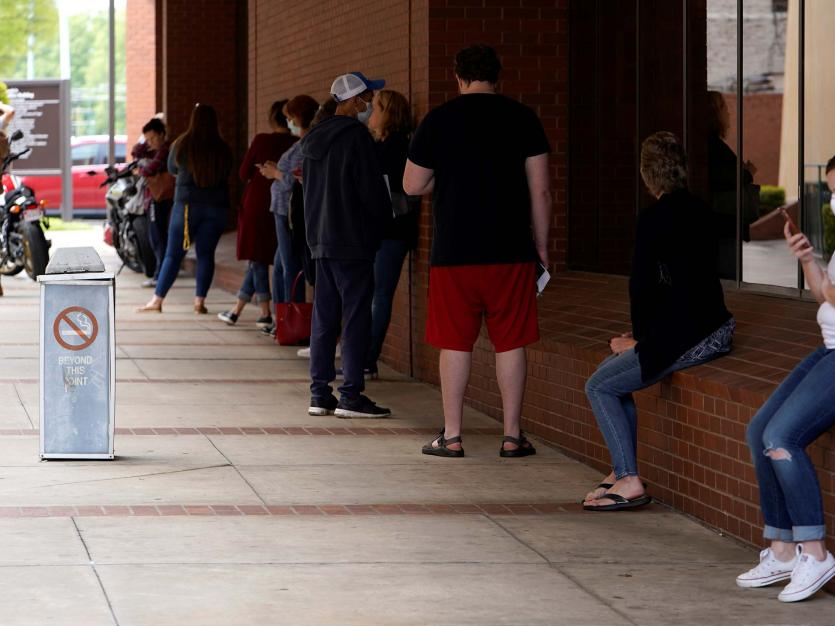People who lost their jobs wait in line to file for unemployment following an outbreak of the coronavirus disease (COVID-19), at an Arkansas Workforce Center in Fort Smith, Arkansas, U.S. April 6, 2020.