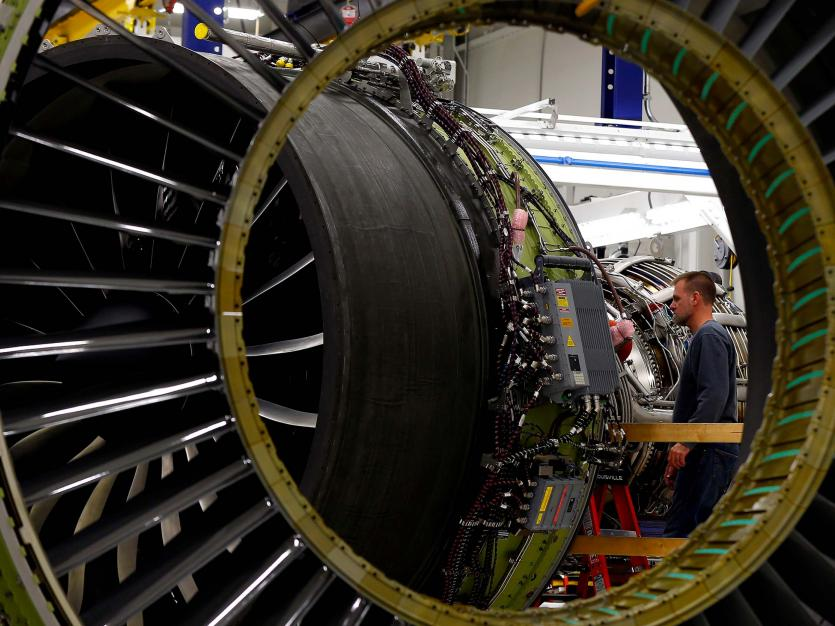 A General Electric employee inspects a jet engine at the GE Aviation Peebles Test Operations Facility in Peebles, Ohio, November 15, 2013.