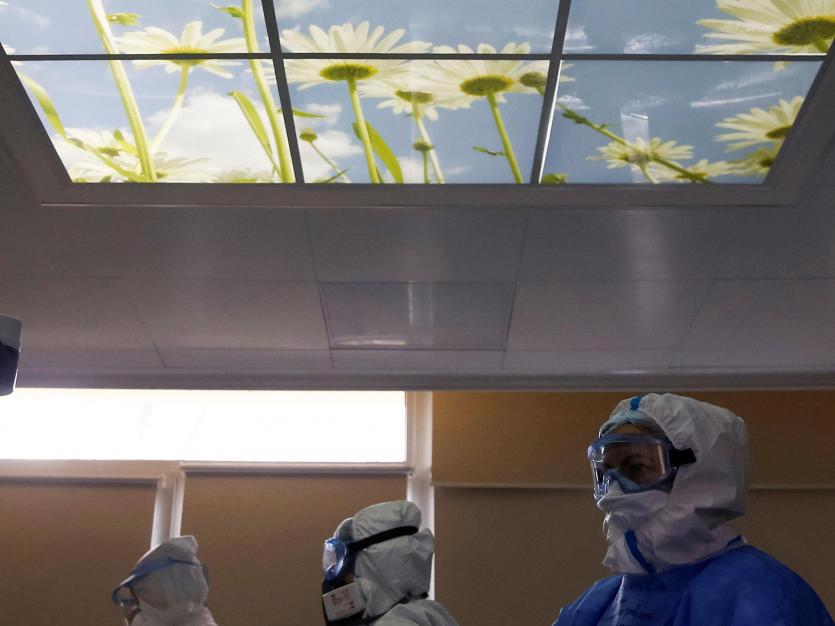 Medical workers wearing personal protective equipment (PPE) work in the Intensive Care Unit (ICU), ECMO Centre of the City Clinical Hospital Number 52, where patients suffering from the coronavirus disease (COVID-19) are treated, in Moscow, Russia
