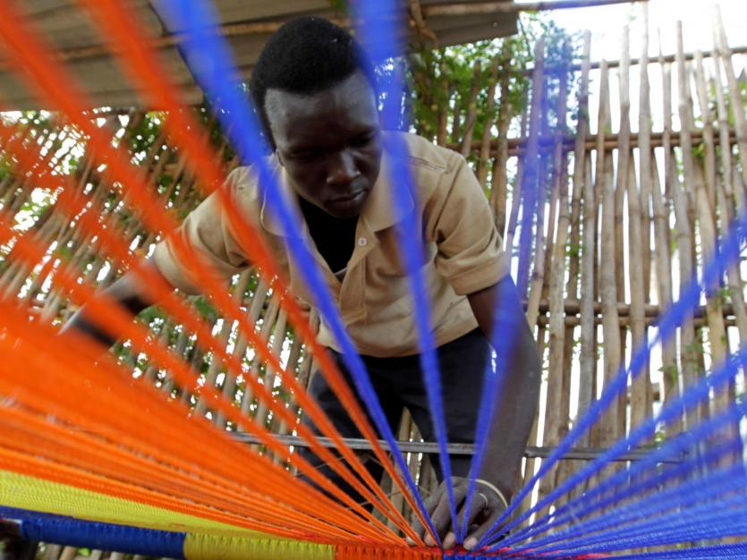 A man weaves a sleeping bed for sale at his workshop on the outskirts of Juba, south Sudan, January 14, 2011.