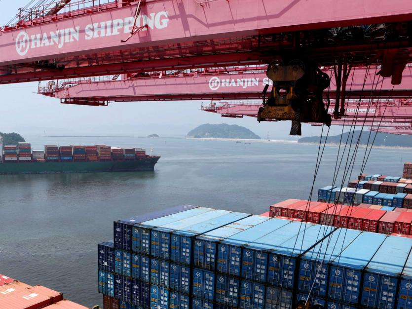 A crane carries a container from a Hanjin Shipping ship at the Hanjin container terminal at the Busan New Port in Busan, about 420 km (261 miles) southeast of Seoul, August 8.