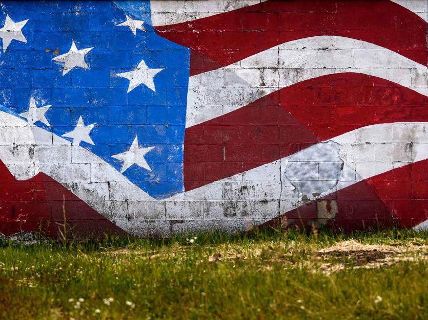 A mural of the United States flag covers the side of a business, in Lansing, Michigan. Photographed on Friday, June 26, 2020. USA TODAY NETWORK via Reuters Connect/Nick King