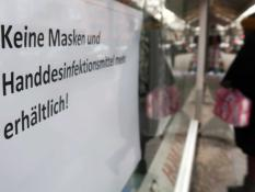 A sign written in German announcing that protective masks and hand sanitiser are sold out is seen at a pharmacy in Berlin, Germany, February 29, 2020.