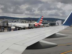 Planes are parked at gates at San Francisco International Airport, as coronavirus disease (COVID-19) disruption continues its spread across the global industry, in San Francisco, California, U.S., March 17, 2020