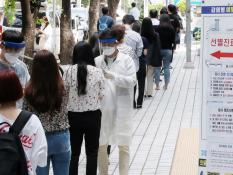 Citizens wait in line to be tested for coronavirus at a clinic in west Seoul, South Korea on May 28, 2020.