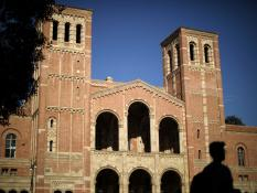 A student walks past Royce Hall on the University of California Los Angeles (UCLA) campus in Los Angeles, California, U.S. REUTERS/Lucy Nicholson