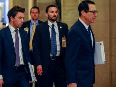 Treasury Secretary Steve Mnuchin arrives for a meeting in the office of U.S. Senate Majority Leader Mitch McConnell (R-KY) to wrap up work on coronavirus economic aid legislation, during the coronavirus disease (COVID-19) outbreak in Washington, U.S.