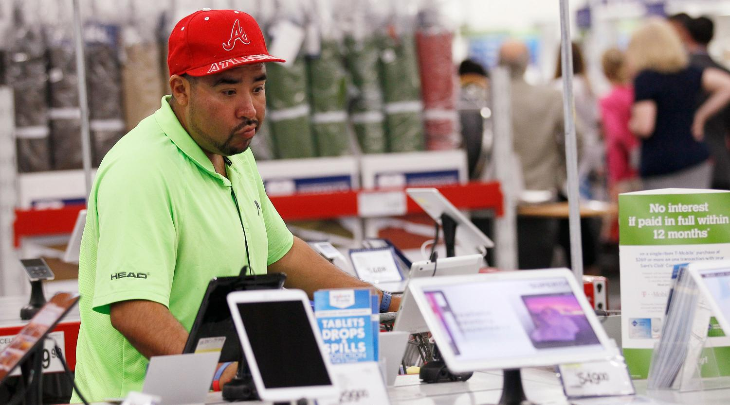 A customer looks over the selection of tablet computers at a Sam's Club in Bentonville, Arkansas