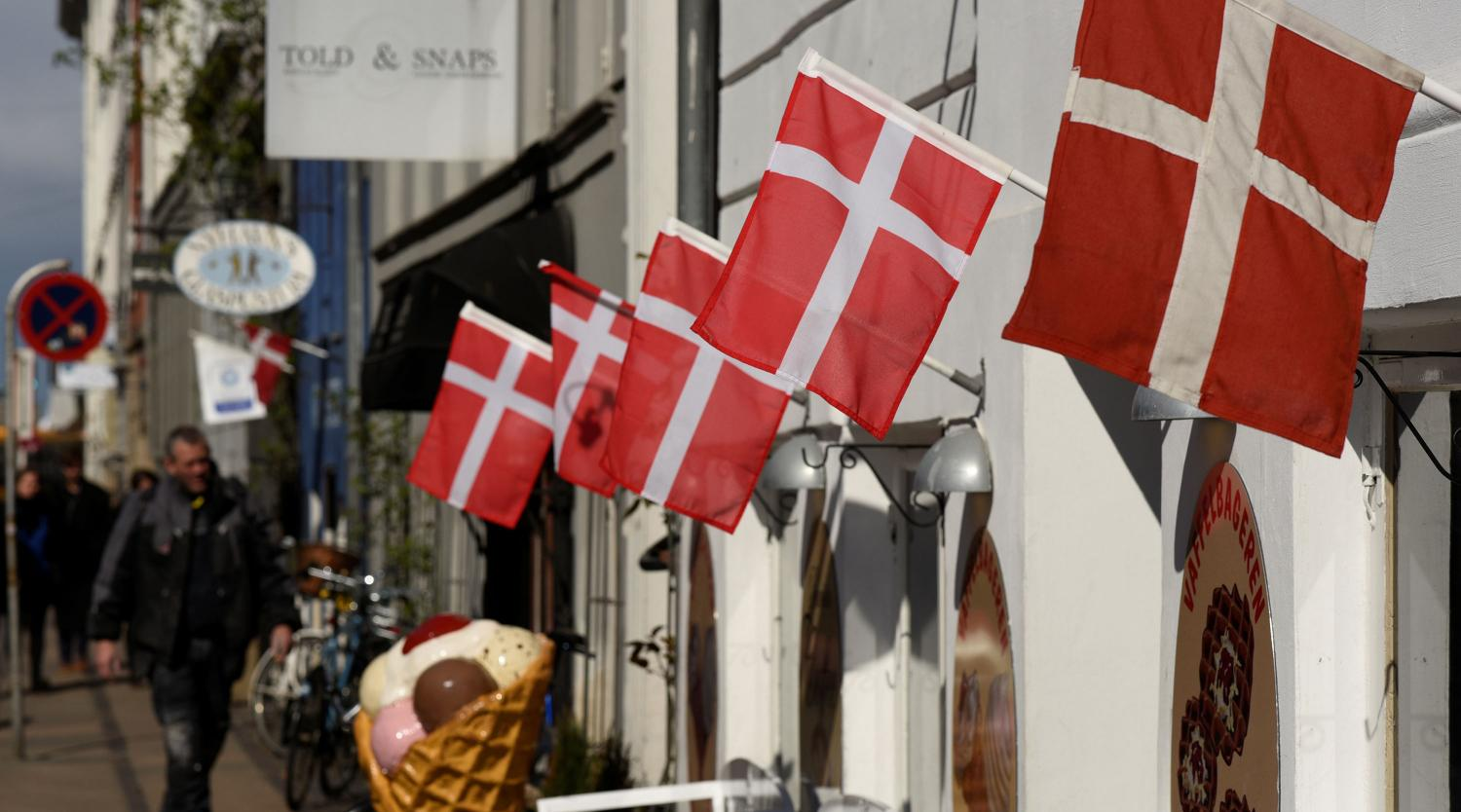 Danish flags are pictured outside a cafe at the famous landmark Nyhavn in Copenhagen, Denmark April 18, 2017.