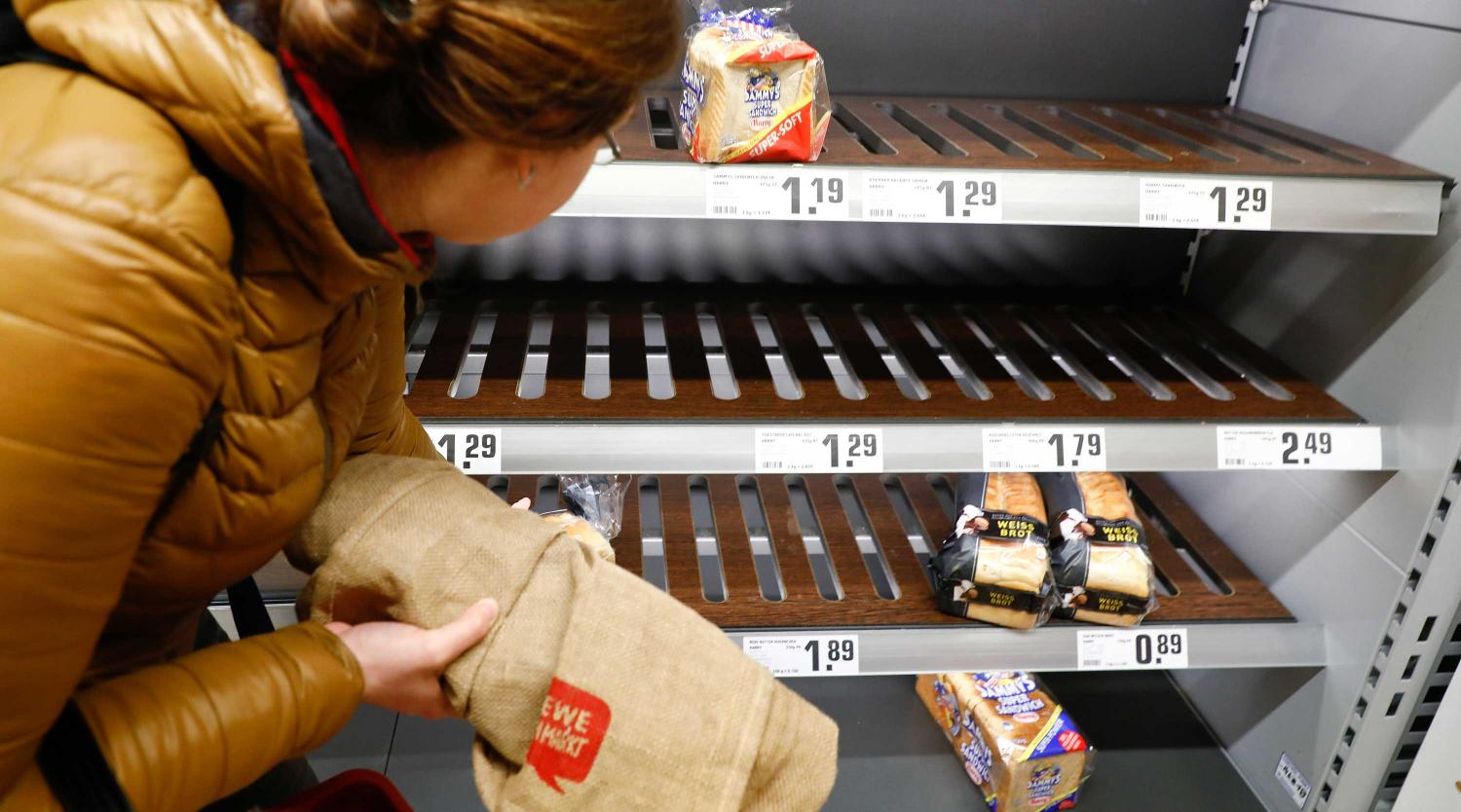 A customer looks at a shelve with bread at a Rewe grocery store in Potsdam, Germany, March 20, 2020, as the spread of the coronavirus disease (COVID-19) continues