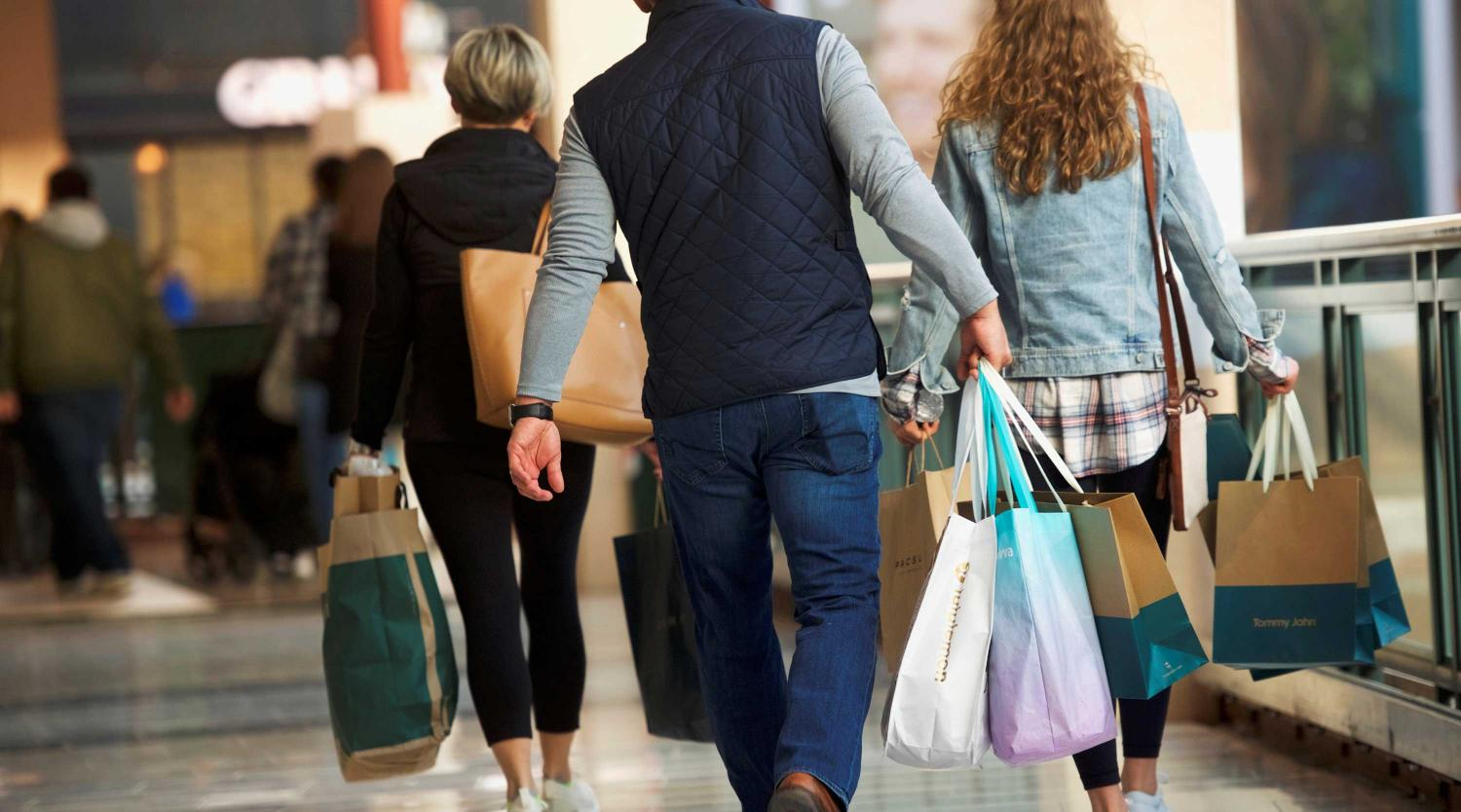 Shoppers carry bags of purchased merchandise at the King of Prussia Mall, United States' largest retail shopping space, in King of Prussia, Pennsylvania, U.S., December 8, 2018.