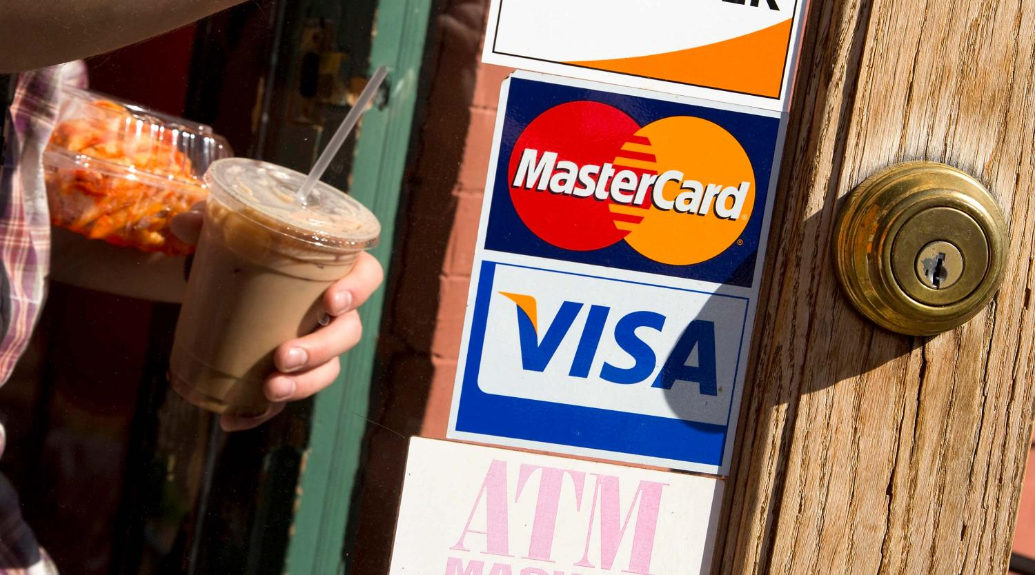 A coffee shop displays signs for Visa and MasterCard, May 1, 2013.