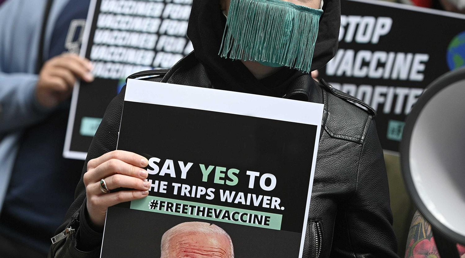 "Activists stand outside Pfizer Headquarters demanding that U.S. President Joe Biden support ""TRIPS Waiver"""